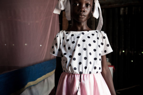 An old face on a young girl in a tent city in Port-au-Prince.